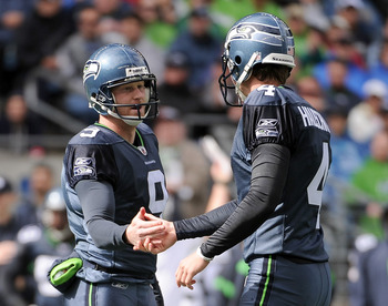 SEATTLE, WA - SEPTEMBER 25:   Steven Hauschka #4 and  Jon Ryan #9 of the Seattle Seahawks celkebrate a field goal for a 3-0 lead over the Arizona Cardinals during the first quarter at CenturyLink Field on September 25, 2011 in Seattle, Washington.  (Photo