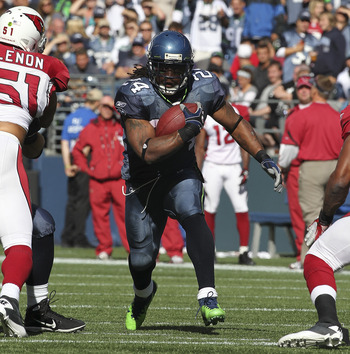 SEATTLE - SEPTEMBER 25:  Running back Marshawn Lynch #24 of the Seattle Seahawks rushes against the Arizona Cardinals at CenturyLink Field on September 25, 2011 in Seattle, Washington. The Seahawks defeated the Cardinals 13-10. (Photo by Otto Greule Jr/Ge