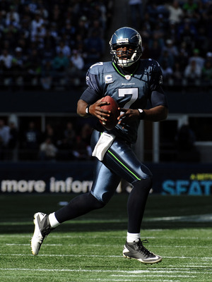 SEATTLE, WA - SEPTEMBER 25:  Tarvaris Jackson #7 of the Seattle Seahawks scrambles out of the pocket on his way to a touchdwon for a 13-10 lead over the Arizona Cardinals during the third quarter at CenturyLink Field on September 25, 2011 in Seattle, Wash