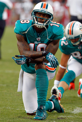 TAMPA, FL - AUGUST 27:  Receiver Brandon Marshall #19 of the Miami Dolphins warms up just before the start of the preseason game against the Tampa Bay Buccaneers at Raymond James Stadium on August 27, 2011 in Tampa, Florida.  (Photo by J. Meric/Getty Imag
