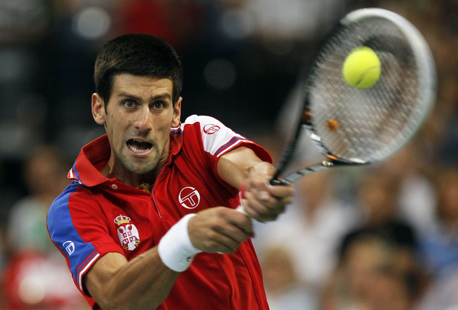 BELGRADE, SERBIA - SEPTEMBER 18: Novak Djokovic of Serbia returns a shot to Juan Martin Del Potro of Argentina during the Davis Cup singles semi final between Serbia and Argentina, at Belgrade Arena on September 18, 2011 in Belgrade, Serbia. (Photo by Srd