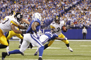 INDIANAPOLIS, IN - SEPTEMBER 25: Rashard Mendenhall #34 of the Pittsburgh Steelers runs with the football during the game against the Indianapolis Colts at Lucas Oil Stadium on September 25, 2011 in Indianapolis, Indiana. The Steelers won 23-20. (Photo by