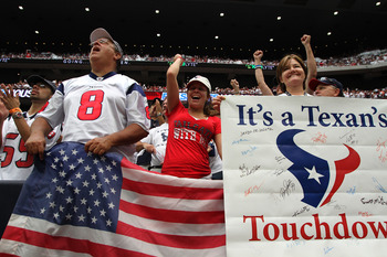 HOUSTON, TX - SEPTEMBER 11:  Houston Texans fans cheer after Houston scored a touchdown against the Indianapolis Colts on September 11, 2011 at Reliant Stadium in Houston, Texas. Texans won 34 to 7.(Photo by Thomas B. Shea/Getty Images)