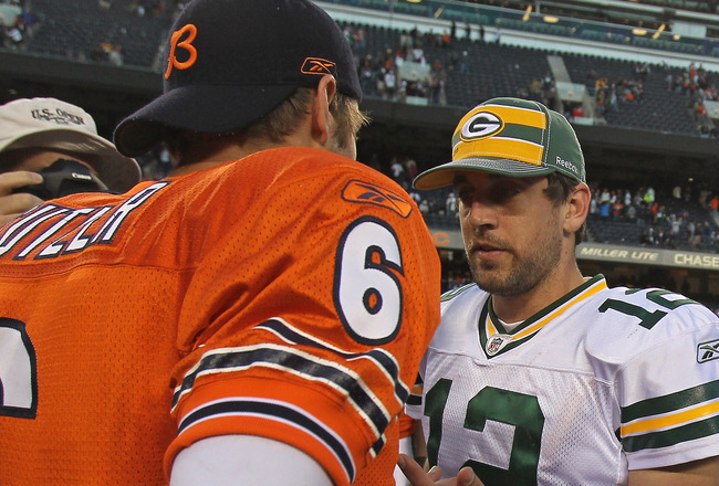 CHICAGO, IL - SEPTEMBER 25: Aaron Rodgers #12 of the Green Bay Packers talks with Jay Cutler #6 of the Chicago Bears after a game at Soldier Field on September 25, 2011 in Chicago, Illinois. The Packers defeated the Bears 27-17. (Photo by Jonathan Daniel/