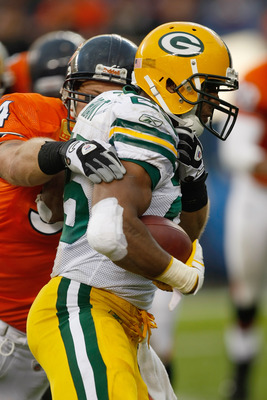 CHICAGO, IL - SEPTEMBER 25: Ryan Grant #25 of the Green Bay Packers runs as he is grabbed by a defender during the game against the Chicago Bears at Soldier Field on September 25, 2011 in Chicago, Illinois. The Packers defeated the Bears 27-17. (Photo by
