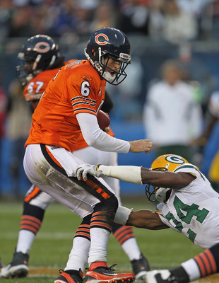 CHICAGO, IL - SEPTEMBER 25:  Jarrett Bush #24 of the Green Bay Packers sacks Jay Cutler #6 of the Chicago Bears at Soldier Field on September 25, 2011 in Chicago, Illinois. The Packers defeated the Bears 27-17.  (Photo by Jonathan Daniel/Getty Images)