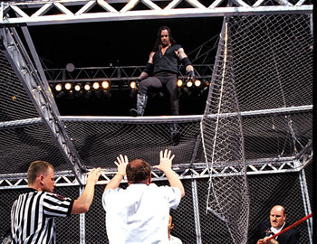 Undertaker surveys the damage after chokeslamming Mankind through the roof of the cell. (Photo by WWE)