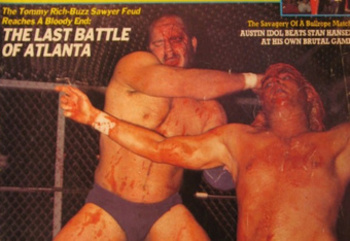 Buzz Sawyer slams Tommy Rich's face into the mat during The Last Battle of Atlanta (Photo by Kappa Publishing/Pro Wrestling Illustrated)