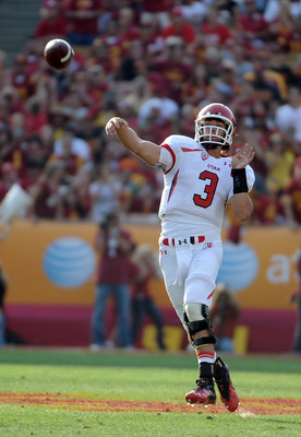 LOS ANGELES, CA - SEPTEMBER 10:  Jordan Wynn #3 of the Utah Utes makes a pass as he rolls out of the pocket against the USC Trojans during the second quarter at Los Angeles Memorial Coliseum on September 10, 2011 in Los Angeles, California.  (Photo by Har