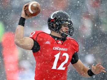 CINCINNATI, OH - DECEMBER 04:  Zach Collaros #12 of the Cincinnati Bearcats throws the ball  during the Big East Conference game against the Pittsburgh Panthers at Nippert Stadium on December 4, 2010 in Cincinnati, Ohio. Pittsburgh won 28-10.  (Photo by A