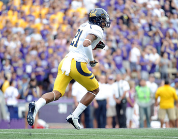 SEATTLE, WA - SEPTEMBER 24:  Keenan Allen #21 of the California Golden Bears runs for a touchdown after a catch against the Washington Huskies for a 7-0 lead during the first quarterat Husky Stadium on September 24, 2011 in Seattle, Washington.  (Photo by