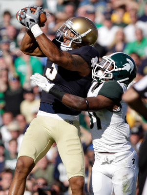 SOUTH BEND, IN - SEPTEMBER 17:  Michael Floyd #3 of the Notre Dame Fighting Irish catches the ball while Darqueze Dennard #31 of the Michigan State Spartans works to break up the pass during the first half September 17, 2011at Notre Dame Stadium in South