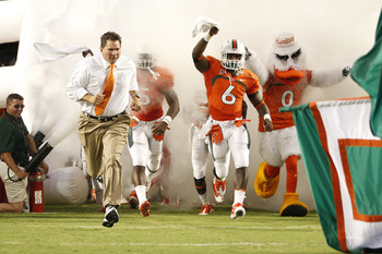 MIAMI, FL - SEPTEMBER 17: Head Coach Al Golden of the Miami Hurricanes leads the team onto the field for his first home game against the Ohio State Buckeyes on September 17, 2011 at Sun Life Stadium in Miami, Florida. The Hurricanes defeated the Buckeyes
