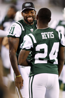 EAST RUTHERFORD, NJ - SEPTEMBER 01:   Antonio Cromartie #31 and  Darrelle Revis #24 of the New York Jets  stand on the sidelines during a pre-season game against the Philadelphia Eagles at MetLife Stadium on September 1, 2011 in East Rutherford, New Jerse