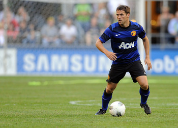 SEATTLE, WA - JULY 20: Michael Owen of Manchester United passes the ball during the first half of the game against the Seattle Sounders FC at CenturyLink Field on July 20, 2011 in Seattle, Washington. (Photo by Steve Dykes/Getty Images)