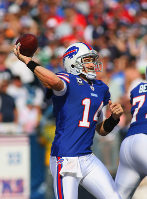 ORCHARD PARK, NY - SEPTEMBER 25:  Ryan Fitzpatrick #14 of the Buffalo Bills throws against the New England Patriots at Ralph Wilson Stadium on September 25, 2011 in Orchard Park, New York.  (Photo by Rick Stewart/Getty Images)