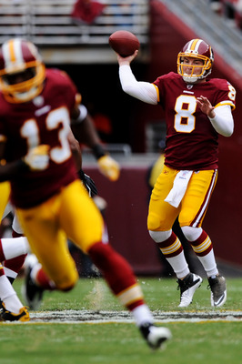 LANDOVER, MD - SEPTEMBER 18: Quarterback Rex Grossman #8 of the Washington Redskins looks for an open receiver against the Arizona Cardinals in the first quarter at FedExField on September 18, 2011 in Landover, Maryland. The Washington Redskins won, 22-21