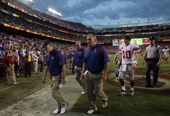 LANDOVER, MD - SEPTEMBER 11:  Head coach Tom Coughlin and  Eli Manning #10 of the New York Giants  walk off the field after losing the season opener against the Washington Redskins at FedExField on September 11, 2011 in Landover, Maryland.  (Photo by Rona