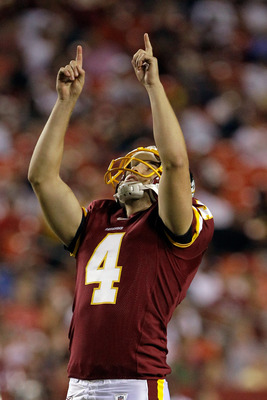 LANDOVER, MD - SEPTEMBER 01: Kicker  Graham Gano #4 of the Washington Redskins celebrates after kicking a field goal against the Tampa Bay Buccaneers during the second  half of a preseason game at FedExField on September 1, 2011 in Landover, Maryland.  (P