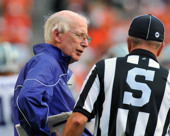 MIAMI GARDENS, FL - SEPTEMBER 24:  Coach Bill Snyder of the Kansas State University Wildcats checks a ruling against the Miami Hurricanes September 24, 2011 at Sun Life Stadium in Miami Gardens, Florida.  (Photo by Al Messerschmidt/Getty Images)