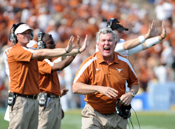 PASADENA, CA - SEPTEMBER 17:  Head Coach Mack Brown of the Texas Longhorns reacts to a call during the game against the UCLA Bruins at Rose Bowl on September 17, 2011 in Pasadena, California.  (Photo by Harry How/Getty Images)