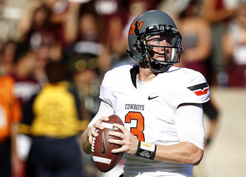 COLLEGE STATION, TX - SEPTEMBER 24:  Quarterback Brandon Weeden #3 of the Oklahoma State Cowboys looks for a receiver  against the Texas A&amp;M Aggies at Kyle Field on September 24, 2011 in College Station, Texas. Oklahoma State won 30-29.  (Photo by Bob Lev