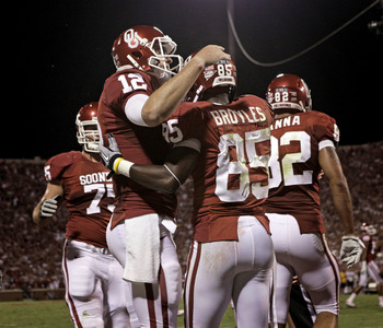 NORMAN, OK - SEPTEMBER 24:  Quarterback Landry Jones #12 congratulates wide receiver Ryan Broyles #85 of the Oklahoma Sooners after scoring a touchdown against the Missouri Tigers on September 24, 2011 at Gaylord Family-Oklahoma Memorial Stadium in Norman