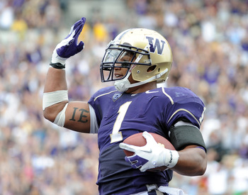 SEATTLE, WA - SEPTEMBER 24:  Chris Polk #1 of the Washington Huskies celebrates his touchdown for a 7-7 score against the California Golden Bears during the first quarter at Husky Stadium on September 24, 2011 in Seattle, Washington.  (Photo by Harry How/