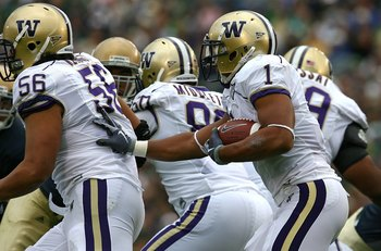 SOUTH BEND, IN - OCTOBER 03: Chris Polk #1 of the Washington Huskies follows blocker Senio Kelemete #56 against the Notre Dame Fighting Irish on October 3, 2009 at Notre Dame Stadium in South Bend, Indiana. Notre Dame defeated Washington 37-30 in overtime