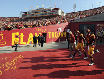 USC football players have entered the Los Angeles Coliseum since it was built in 1923