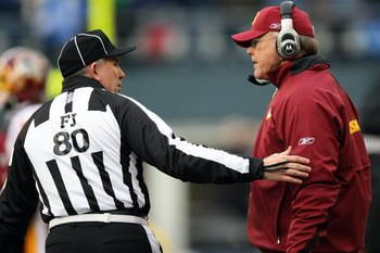 SEATTLE - JANUARY 05:  Head coach Joe Gibbs of the Washington Redskins talks with field judge Greg Gautreaux #80 from the sideline against the Seattle Seahawks in the first quarter during the NFC Wild Card game at Qwest Field on January 5, 2008 in Seattle