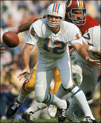 Hall of Famer Bob Griese doing what he does best: Handing the ball off.