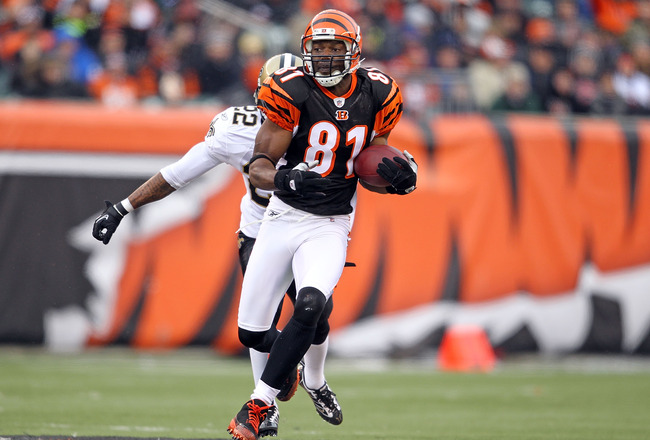 CINCINNATI, OH - DECEMBER 05: Terrell Owens #81 of the Cincinnati Bengals runs with the ball during the NFL game against the New Orleans Saints at Paul Brown Stadium on December 5, 2010 in Cincinnati, Ohio.  The Saints won 34-30.  (Photo by Andy Lyons/Get