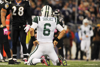 BALTIMORE - OCTOBER 2:  Mark Sanchez #6 of the New York Jets reacts after being sacked by the Baltimore Ravens at M&T Bank Stadium on October 2. 2011 in Baltimore, Maryland. The Ravens defeated the Jets 34-17. (Photo by Larry French/Getty Images)
