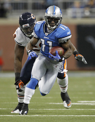 DETROIT - DECEMBER 05: Stefan Logan #11 of the Detroit Lions runs for a first down during the second quarter as Henry Melton #69 of the Chicago Bears give chase during the game at Ford Field on December 5, 2010 in Detroit, Michigan.  (Photo by Leon Halip/