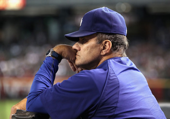 PHOENIX - SEPTEMBER 24:  Manager Joe Torre of the Los Angeles Dodgers watches from the dugout during the Major League Baseball game against the Arizona Diamondbacks at Chase Field on September 24, 2010 in Phoenix, Arizona.  (Photo by Christian Petersen/Ge