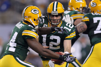 ARLINGTON, TX - FEBRUARY 06: Aaron Rodgers #12 of the Green Bay Packers hands the ball off to James Starks #44 during Super Bowl XLV at Cowboys Stadium on February 6, 2011 in Arlington, Texas.  (Photo by Jamie Squire/Getty Images)