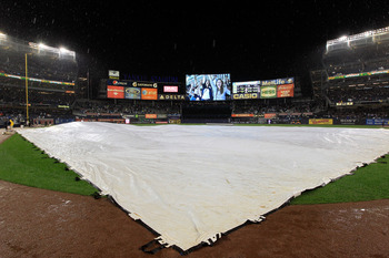 The tarp came out early and stayed on causing Game 1 to be delayed