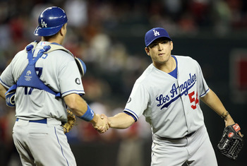 Javy Guerra shaking hands after his 21st and final save of 2011.