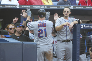 Lucas Duda returns to the dugout after his 10th homer of the year.