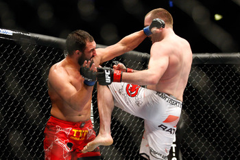 MONTREAL- MAY 8: TJ Grant (R) knees Johny Hendricks in their welterweight bout at UFC 113 at Bell Centre on May 8, 2010 in Montreal, Quebec, Canada.  (Photo by Richard Wolowicz/Getty Images)