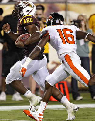 Arizona State running back Cameron Marshall (6) scores a touchdown as Oregon State cornerback Rashaad Reynolds (16) pursues during the second half of an NCAA college football game, Saturday, Oct. 1, 2011, in Tempe, Ariz. (AP Photo/Matt York)