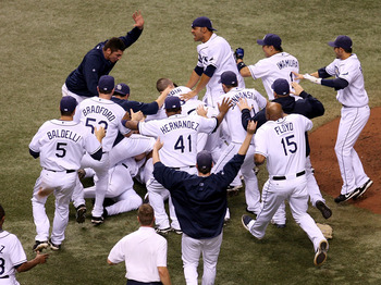 ST PETERSBURG, FL - OCTOBER 19:  The Tampa Bay Rays celebrate after defeating the Boston Red Sox in game seven of the American League Championship Series during the 2008 MLB playoffs on October 19, 2008 at Tropicana Field in St Petersburg, Florida.  The R