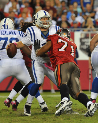 TAMPA, FL - OCTOBER 3:  Defensive lineman Michael Bennett #71 of the Tampa Bay Buccaneers tackles quarterback Curtis Painter #7 of  the Indianapolis Colts October 3, 2011 at Raymond James Stadium in Tampa, Florida. (Photo by Al Messerschmidt/Getty Images)