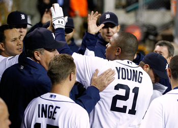 Delmon Young is greeted by teammmates after his go ahead homerun