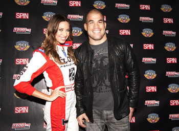 INDIANAPOLIS, IN - MAY 27:  MMA fighter Tito Ortiz poses for a photo with IZOD Trophy Girl Cameron Haven before the IZOD and Spin Magazine 100th Anniversary Indianapolis 500 Welcome Party during the weekend of the 95th running of the Indianapolis 500 on M