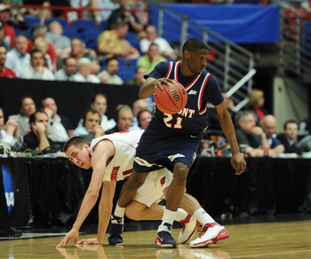 TUCSON, AZ - MARCH 17:  Ian Clark #21 of the Belmont Bruins steals the ball from Josh Gasser #21 of the Wisconsin Badgers during the second round of the 2011 NCAA men's basketball tournament at McKale Center on March 17, 2011 in Tucson, Arizona.  (Photo b
