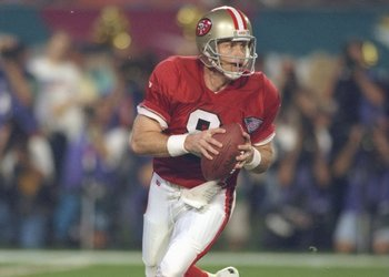 Steve Young brought the best of both worlds together first.  A mobile quarterback was married to the west coast offense.