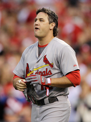 PHILADELPHIA, PA - OCTOBER 01:  Lance Berkman #12 of the St. Louis Cardinals reacts after hitting a fly ball to end the third inning against the Philadelphia Phillies during Game One of the National League Division Series at Citizens Bank Park on October