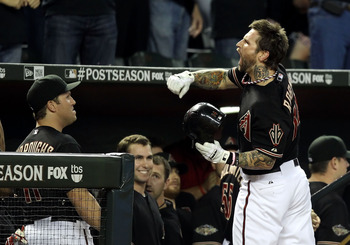 PHOENIX, AZ - OCTOBER 05:  Ryan Roberts #14 of the Arizona Diamondbacks celebrates after hitting a grand slam home run in the first inning against the Milwaukee Brewers in Game Four of the National League Divison Series at Chase Field on October 5, 2011 i